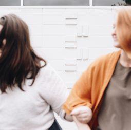 women arm in arm